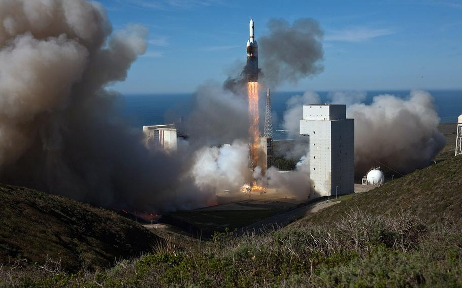 With the Pacific Ocean in the background, a rocket launches from Vandenberg Air Force Base, Calif. on Jan. 21, 2011.