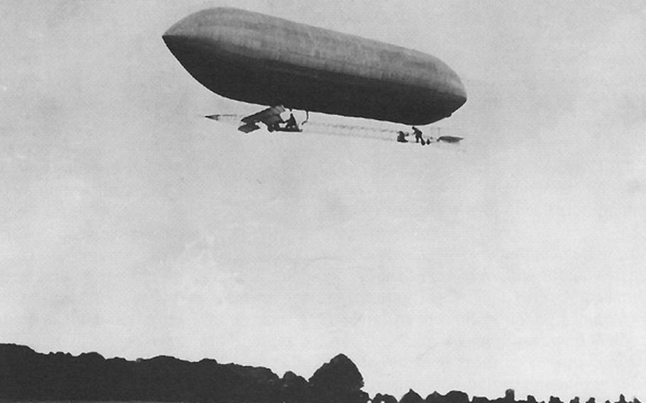 A U.S. Army dirigible flies above Fort Myer, Va., in 1908.