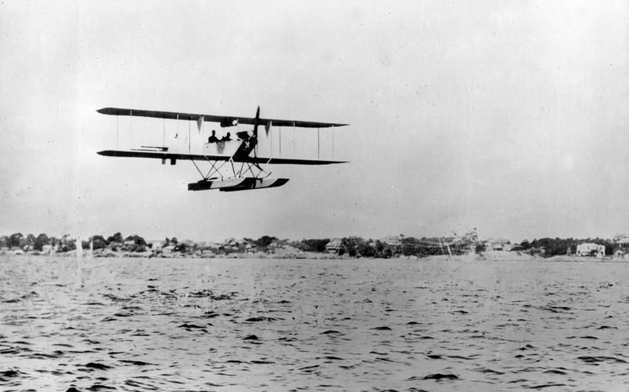 The Army's first tractor aircraft—the Burgess hydro Signal Corps No. 9—flies above the water at Salem, Mass., in July of 1912.