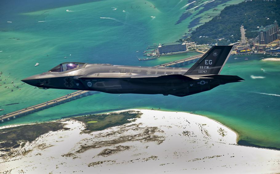 An F-35 Lightning II flies over Destin, Fla., before landing at its new home at Eglin Air Force Base, Fla., July 14, 2011. Its pilot, Lt. Col. Eric Smith is the first Air Force qualified F-35 pilot and is assigned to the 58th Fighter Squadron. (U.S. Air Force photo/Staff Sgt. Joely Santiago)