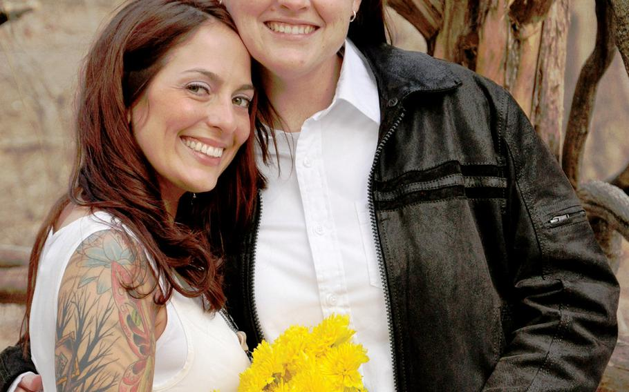 Air Force Master Sgt. Angela Shunk, left, and Tech. Sgt. Stacey Shunk, married in March in New York City's Central Park. The couple wants to start a family but faces an uncertain future together, since the Air Force won't allow them to apply to a program that tries to match military spouses with assignments at the same location. A federal law prevents U.S. government entities from recognizing the legal marriages of same-sex couples.