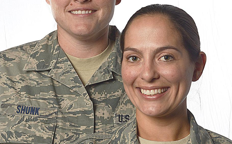 Tech. Sgt. Stacey Shunk, left, and Master Sgt. Angela Shunk are the first Air Force same-sex couple to be accepted for an assignment under the service's Join Spouse program.