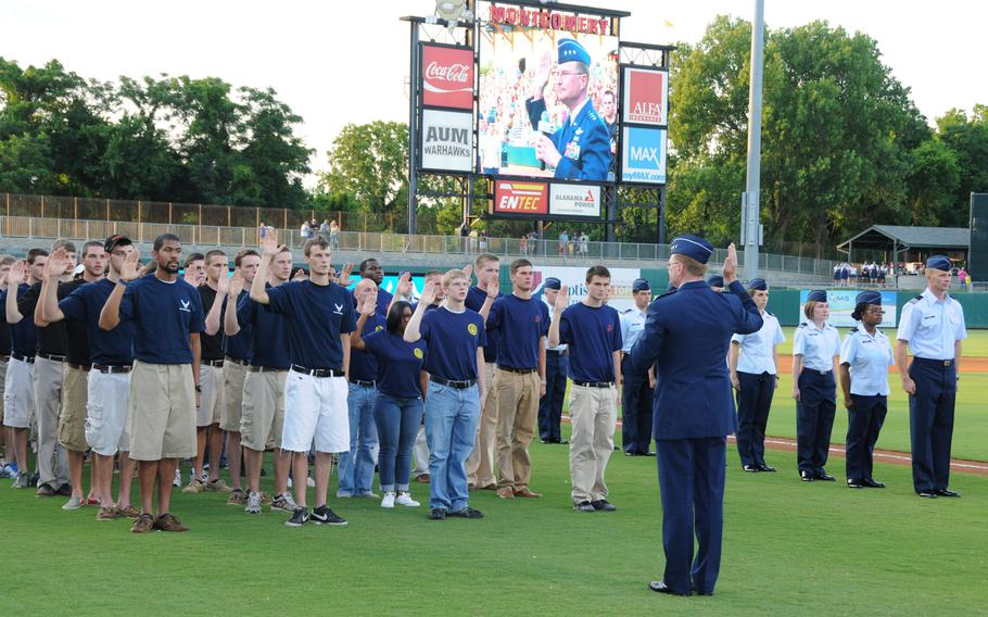 U.S. Air Force Lt. Gen. David S. Fadok delivers the oath of enlistment to new Air Force enlistees during Military Appreciation night at Riverwalk Stadiumin Montgomery, Ala., June 2, 2012.
