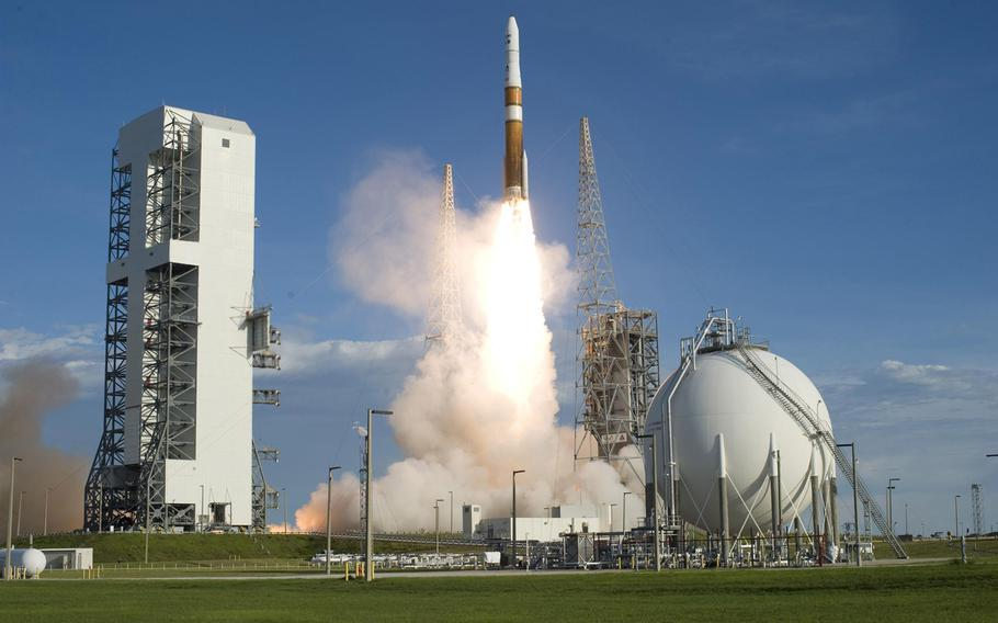 Smoke and steam roll across Launch Complex 37 at Cape Canaveral Air Force Station in Florida as a Delta IV rocket clears the tower in this June 2009 photo.