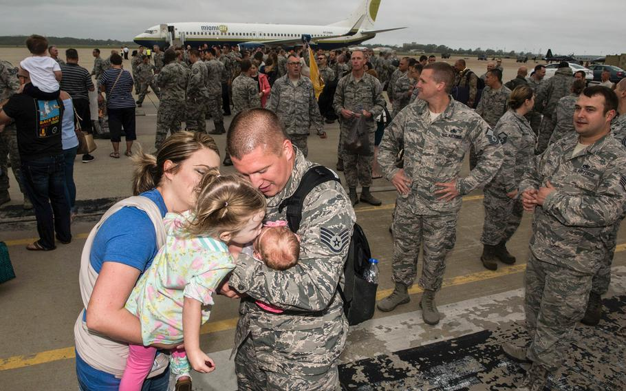 Staff Sgt. Spencer Chamber hugs his new-born baby Xanthe, whom he has never met, after his return to Joint Base Langley-Eustis, Va., on Thursday Oct. 12, 2017, from a six-month deployment to the Middle East in participation of Operation Inherent Resolve.