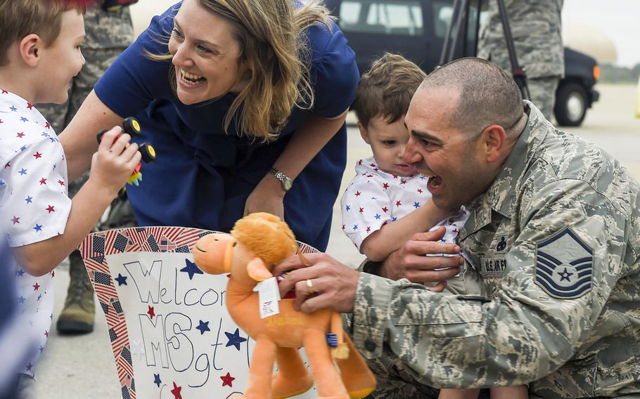 Master Sgt. Jeremiah Clarson, the 192nd Maintenance Squadron quality assurance inspector, greets his family at Joint Base Langley-Eustis, Va., on Thursday, Oct. 12, 2017.