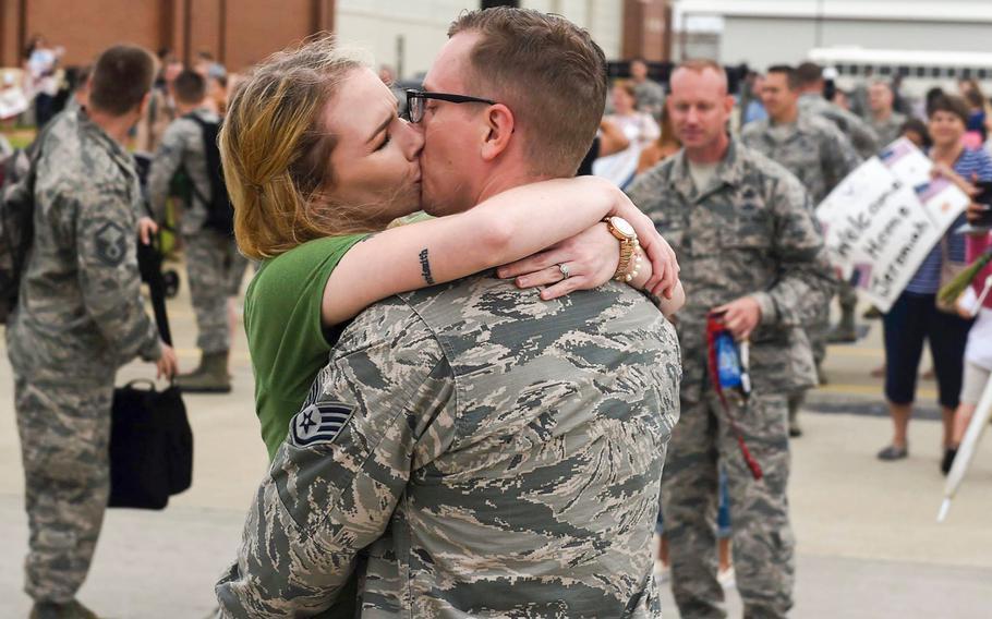 Sgt. Nathaniel Sorensen, 633rd Communications Squadron client systems supervisor, kisses his wife Sarah Sorensen, at Joint Base Langley-Eustis, Va., on Thursday, Oct. 12, 2017.