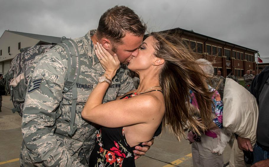 Virginia Air National Guard Staff Sgt. Jeff Greenquist, 192nd Maintenance Squadron low observable technician, kisses his fiancé Ashley Branham, at Joint Base Langley-Eustis, Va., on Thursday, Oct. 12, 2017, after she accepted his proposal to marry her.