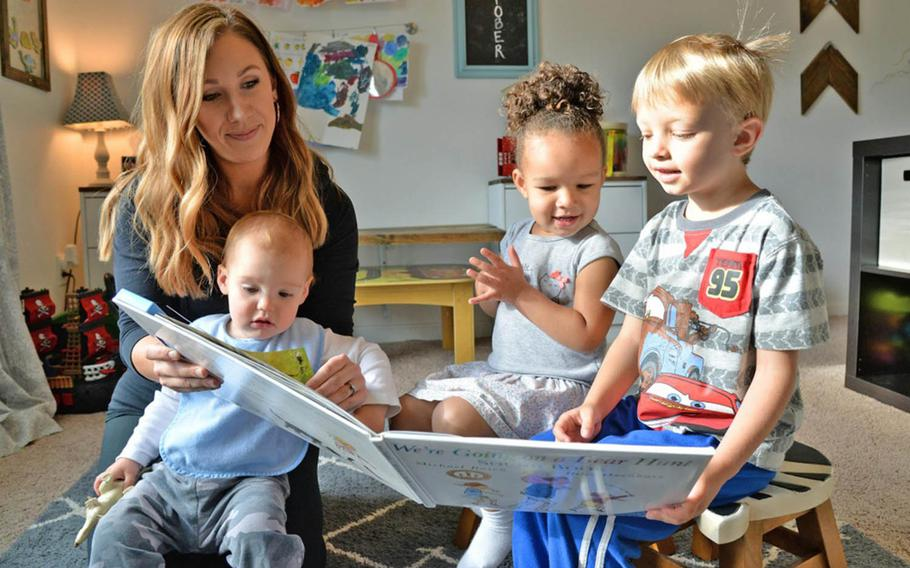 Family Child Care provider Emily Horn reads to children on Oct. 5, 2017,  at her home on Hanscom Air Force Base, Mass.