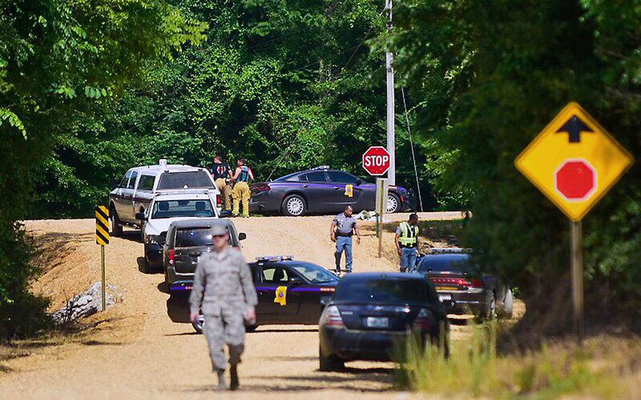 Authorities with Columbus Air Force Base work with local law enforcement and fire departments in responding to the scene of a U.S. Air Force T-38C Tallon II training jet crash, near the Lowndes-Monroe County line near Columbus, Miss., early Wednesday, May 23, 2018.
