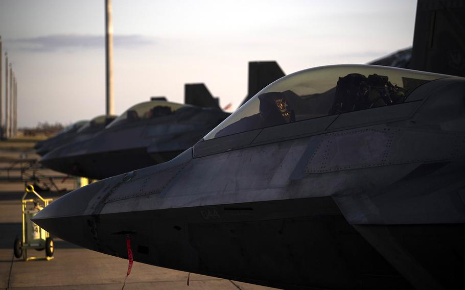 F-22 Raptors are parked near the runway at Tyndall Air Force Base, Florida, Oct. 15, 2018.