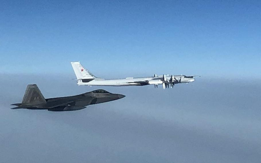 A North American Aerospace Defense Command F-22 fighter aircraft, left, intercepts a Russian Tu-95 bomber late Monday, Oct. 19, 2020.