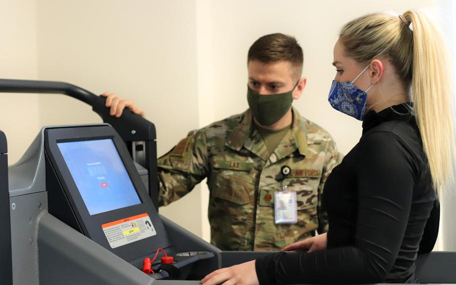 Maj. John Lax, a primary care and sports medicine physician with the 31st Medical Group at Aviano Air Base, Italy, watches as Air Force Staff Sgt. Katelyn Ramsey gets ready to use a treadmill that enables pain-free movement by reducing gravitational load and body weight, at the Comprehensive Operational Medicine for Battle Ready Airmen, or COBRA, clinic.