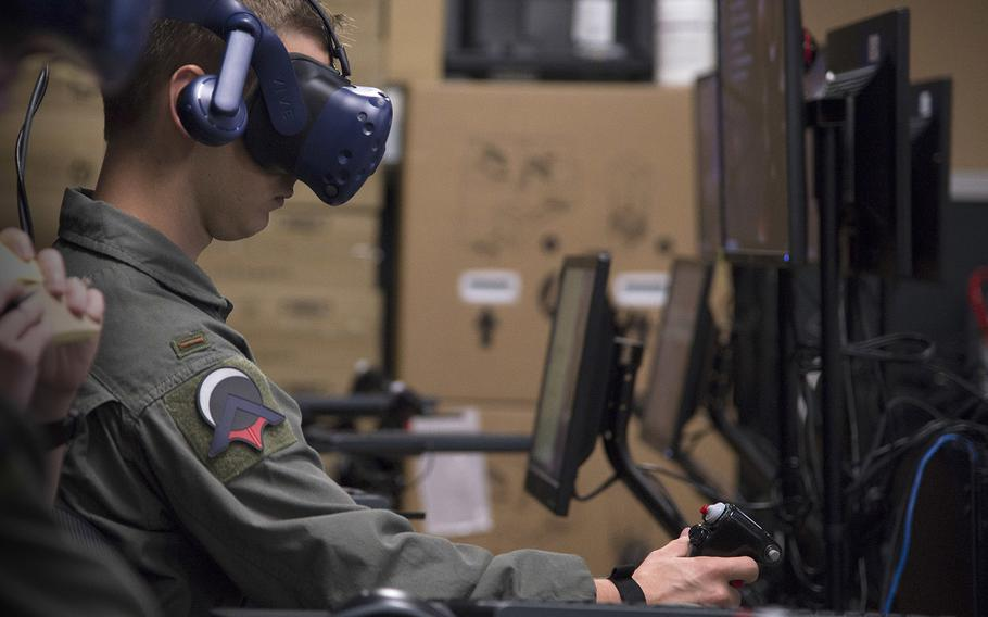 Second Lt. Austin Sneed, a Pilot Training Next student, trains on a virtual-reality flight simulator at the Armed Forces Reserve Center in Austin, Texas, on June 18, 2018. The training program is being used to redesign pilot training.