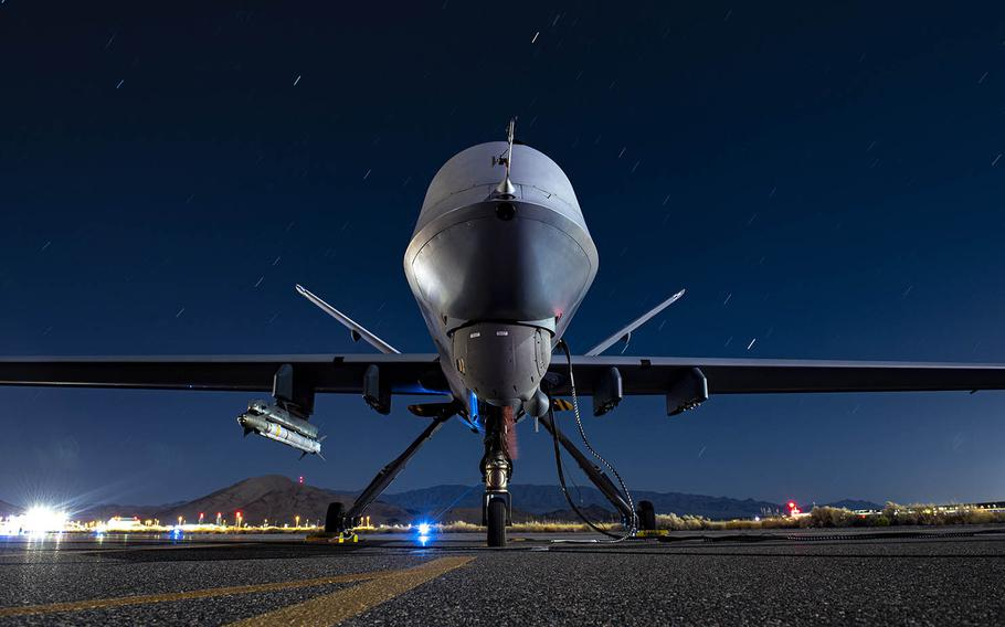 An Air Force MQ-9 Reaper armed with an AIM-9X Block 2 missile sits on the ramp at Creech Air Force Base, Nevada, Sept. 3, 2020. The drone is assigned to the 556th Test and Evaluation Squadron.