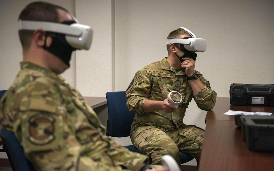 Air Force drone instructors test out Oculus Quest 2 virtual reality headsets at Holloman Air Force Base, N.M., April 12, 2021.