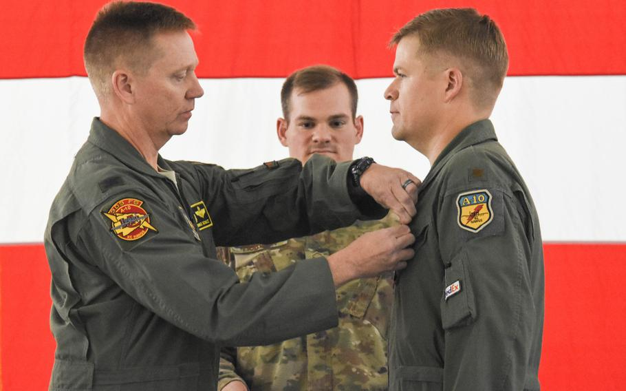 Col. Mike Schultz, commander of the 442nd Fighter Wing, pins the Distinguished Flying Cross on Maj. John Tice, a flight commander with the 303rd Fighter Squadron, during a ceremony at Whiteman Air Force Base, Mo., in November of 2019.