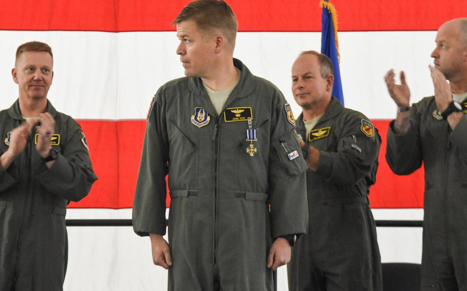 Maj. John Tice, a flight commander with the 303rd Fighter Squadron, center, received the Distinguished Flying Cross and is recognized during a ceremony at Whiteman Air Force Base, Mo., in November of 2019. Tice was awarded for a mission he flew out of Kandahar Air Base, Afghanistan, in December 2010.