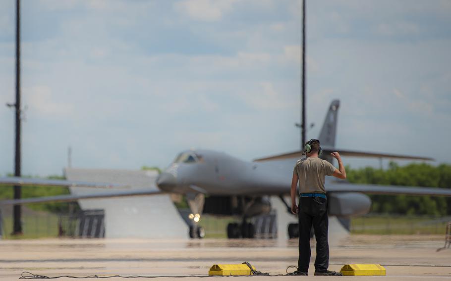 Senior Airman Brent Cook marshals a B-1B Lancer at Dyess Air Force Base, Texas, May 31, 2020.