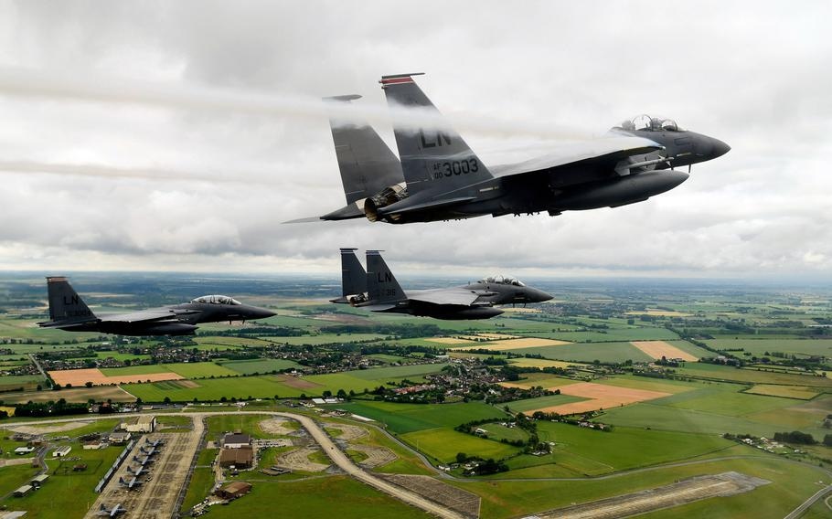 """F-15E Strike Eagles from the 494th Fighter Squadron conduct a missing man formation on Thursday, June 19, 2020, in honor of 1st Lt. Kenneth """"Kage"""" Allen, who died four days earlier when his F-15C fighter jet crashed in the North Sea."""
