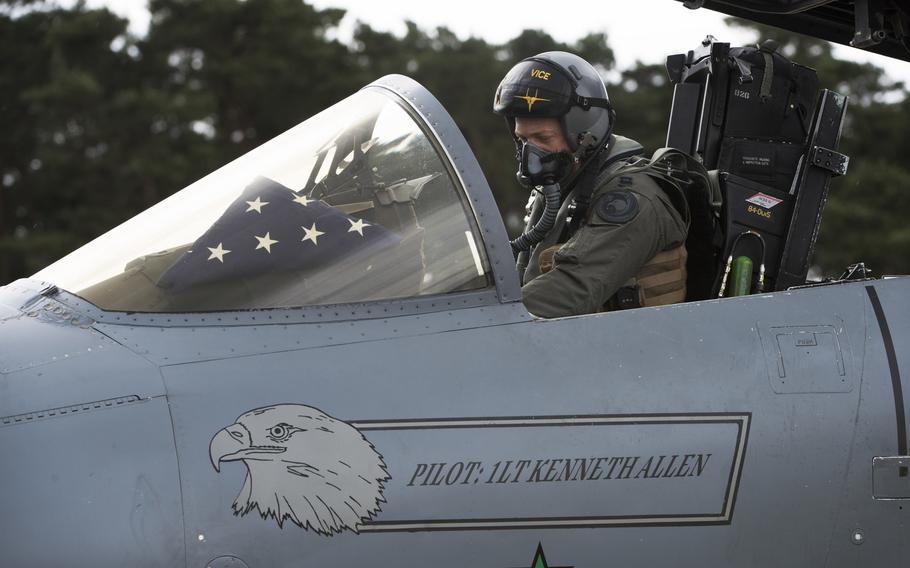 """A pilot assigned to the 493rd Fighter Squadron prepares to depart for depot maintenance at Robins Air Force Base, Ga., from RAF Lakenheath, England, June 19, 2020. The name of 1st Lt. Kenneth """"Kage"""" Allen, who died when his F-15C crashed in the North Sea during routine training on Monday, June 15, is painted on the jet."""