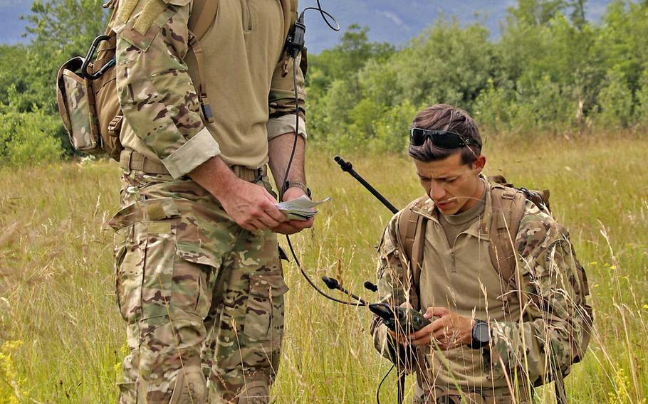 Master Sgt. Donald A. Jones, left, with the 56th Rescue Squadron and Tech. Sgt. Dylan Sedillo, of the the 31st Operations Support Squadron, conduct communications checks during Operation Porcupine, held in the town of Osoppo, Italy. The annual exercise was created to promote coordination among 31st Fighter Wing units at Aviano Air Base.