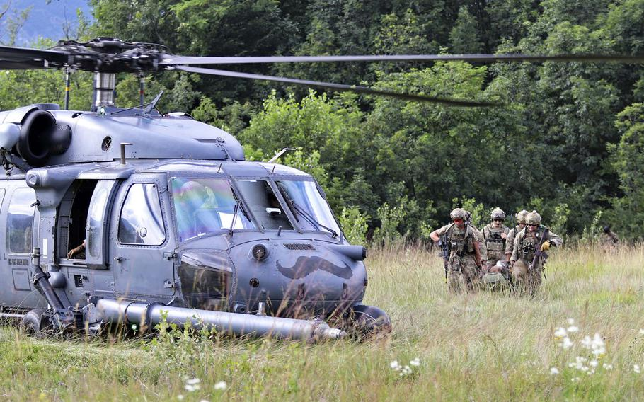 Pararescuemen with the 57th Rescue Squadron, Aviano Air Base, Italy, attempt in an exercise to extract a downed pilot from a contested area during Operation Porcupine, held at an Italian army training area in the town of Osoppo, June 30, 2020.
