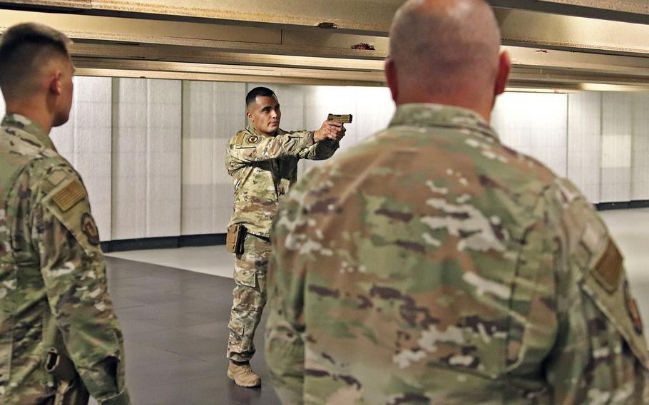 Staff Sgt. Enrique Salas, the Combat Arms Instructor for the 31st Security Forces Squadron at Aviano Air Base, Italy, instructs airmen on the proper engagement of their weapons, prior to a marksmanship qualification session with M4 carbines and the M18 handgun, July 14, 2020. The Air Force has chosen the M18 as its new service pistol, replacing the M9 Beretta, which has been in service for 30 years.