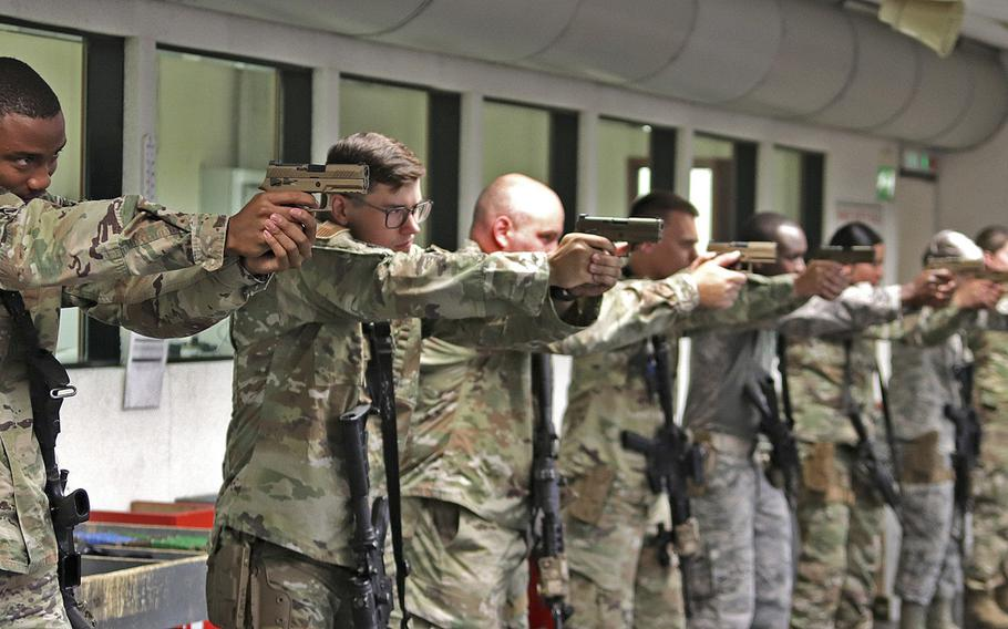 Security forces airmen assigned to the 31st Security Forces Squadron at Aviano practice drawing and aiming with their M18 service pistols, prior to a qualification session, July 14, 2020, at Aviano Air Base, Italy. The Air Force has chosen the M18 as its new service pistol, replacing the M9 Beretta, which has been in service for 30 years.