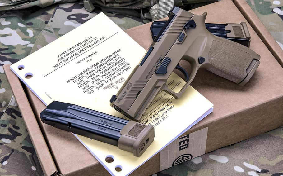 The Sig Sauer M18 is a 9-mm, striker-fired pistol with a coyote-tan PVD coated stainless steel slide with black controls. The Air Force has chosen the M18 as its new service pistol, replacing the M9 Beretta, which has been in service for 30 years.
