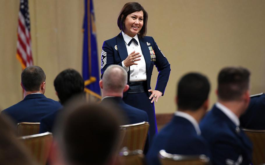 Air Force Chief Master Sgt. JoAnne Bass sports the mess dress uniform while speaking at Keesler Air Force Base, Miss., April 19, 2019. The Air Force has now replaced the floor-length skirt with trousers.
