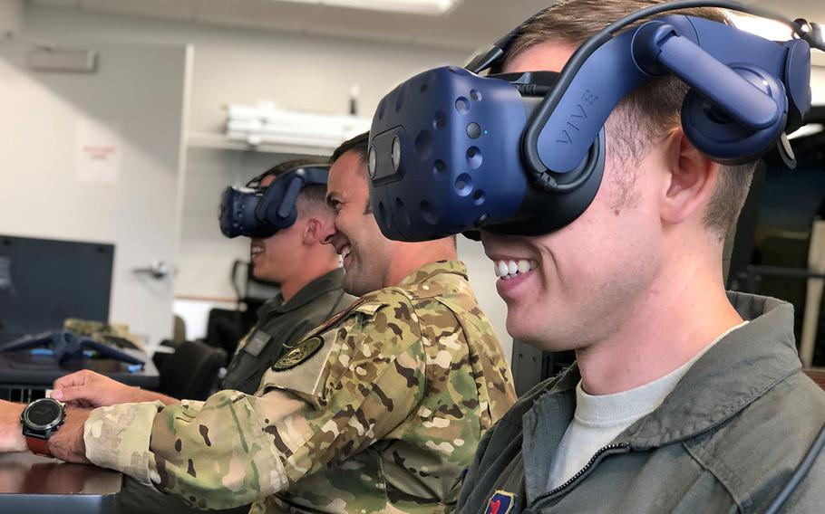 Students and an instructor pilot with the 23rd Flying Training Squadron take part in a virtual reality sortie during training at Fort Rucker, Ala., Oct. 9, 2019.