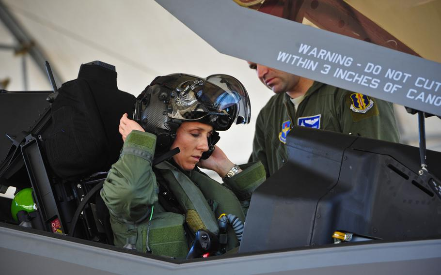 Lt. Col. Christine Mau, 33rd Operations Group deputy commander, puts on her helmet before taking her first flight in the F-35A on Eglin Air Force Base, Fla., May 2015. The Air Force is offering at least $100,000 in prize money to inventors who develop systems that allow female pilots to relieve themselves in flight.