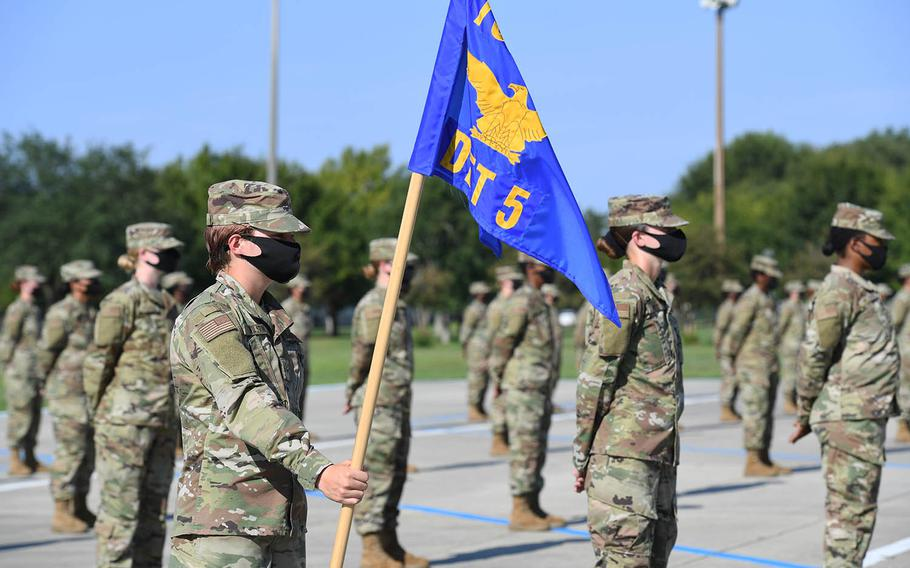 Air Force trainees stand in formation while graduating from basic military training at Keesler Air Force Base, Miss., Aug. 21, 2020.