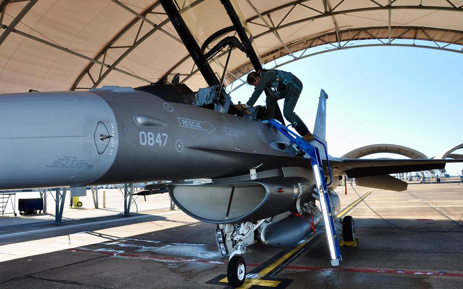 First Lt. Elizabeth Pennell, a T-38 pilot, steps into an F-16D Fighting Falcon at Eglin Air Force Base, Fla., while testing a modified version of the Air Force's G-suit in late October.