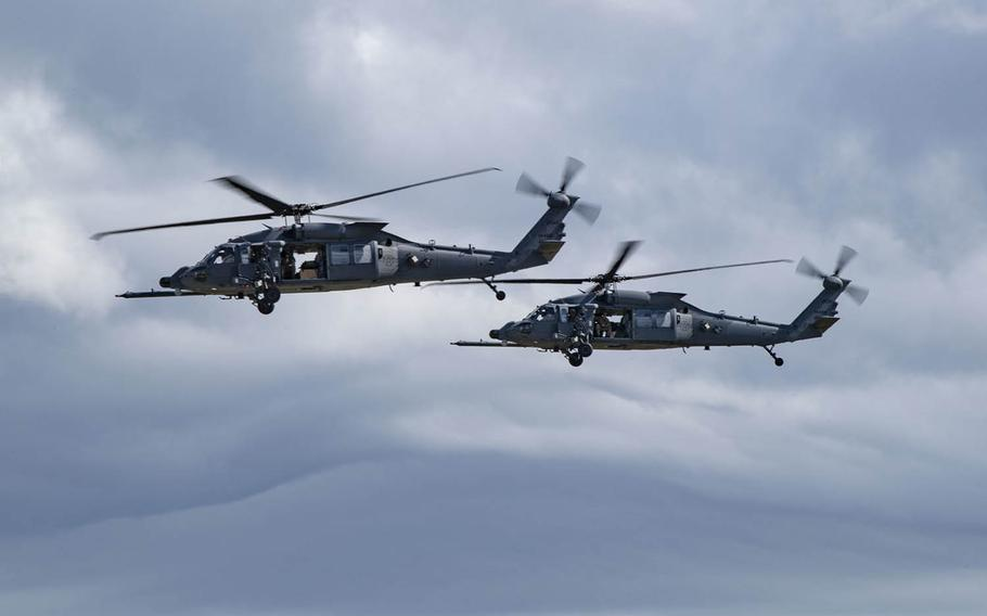 A pair of HH-60W Jolly Green II helicopters prepare to land at Moody Air Force Base, Ga., Nov. 5, 2020.