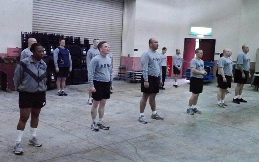 """The Army is ordering hardened combat veterans to wear fake breasts and """"empathy bellies,"""" like the one worn by the third soldier from the left, so they can better understand how pregnant female soldiers feel during physical training."""