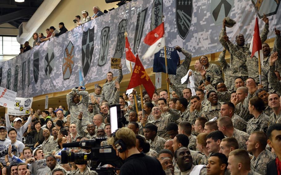 U.S. servicemembers cheer during the 2013 Armed Forces Classic basketball game, held at the Camp Humphreys Community Fitness Center in South Korea on Saturday, Nov. 9, 2013. Oregon went on to beat Georgetown 82-75. The televised game was part of ESPN's Veterans Week, meant to honor the U.S. military.