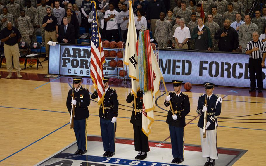U.S. Forces Korea color guard stands at attention during the playing of the national anthem at the 2013 Armed Forces Classic basketball game at Camp Humphreys Community Fitness Center in South Korea on Saturday, Nov. 9, 2013. Oregon beat Georgetown 82-75. The televised game was part of ESPN's Veterans Week, meant to honor the U.S. military.
