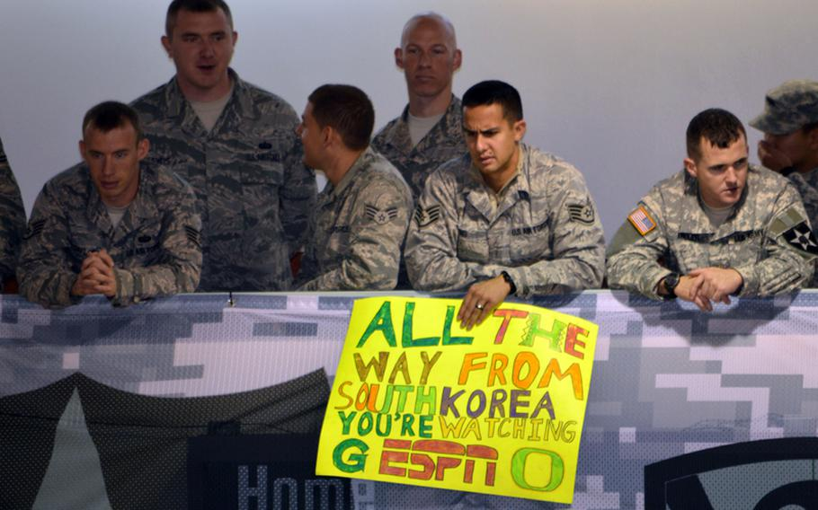 Staff Sgt. Travis Ng holds a game sign during the 2013 Armed Forces Classic basketball game at Camp Humphreys Community Fitness Center in South Korea on Saturday, Nov. 9, 2013. Ng, an airman with the 51st Communications Squadron at Osan Air Base, rooted for Oregon during the game.