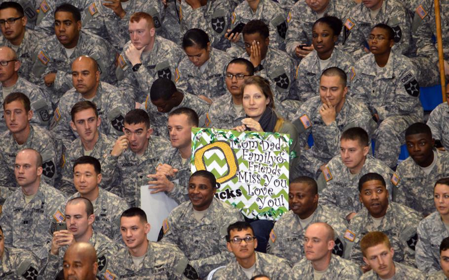 An Oregon fan holds a game sign during the 2013 Armed Forces Classic basketball game at Camp Humphreys Community Fitness Center in South Korea on Saturday, Nov. 9, 2013.