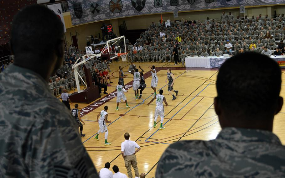 Airmen enjoy the 2013 Armed Forces Classic basketball game at Camp Humphreys, South Korea, on Saturday, Nov. 9, 2013. Oregon took on Georgetown during the NCAA season-opener and won 82-75.