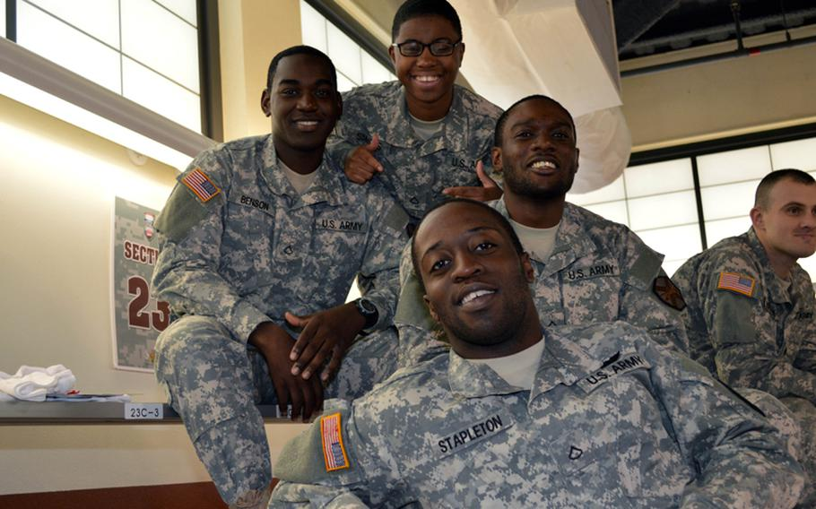 U.S. soldiers from Camp Red Cloud Headquarters and Headquarters Company enjoy the 2013 Armed Forces Classic NCAA basketball game at Camp Humphreys, South Korea, on Saturday, Nov. 9, 2013.
