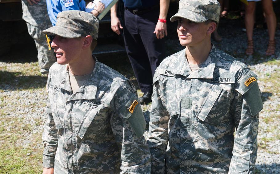 Capt. Kristen Griest (right) and 1st Lt. Shaye Haver (left) receive their Ranger tab during their graduation From the U.S. Army Ranger School at Fort Benning, Ga., Aug. 21, 2015.  Griest and Haver became the first female graduates of the school.