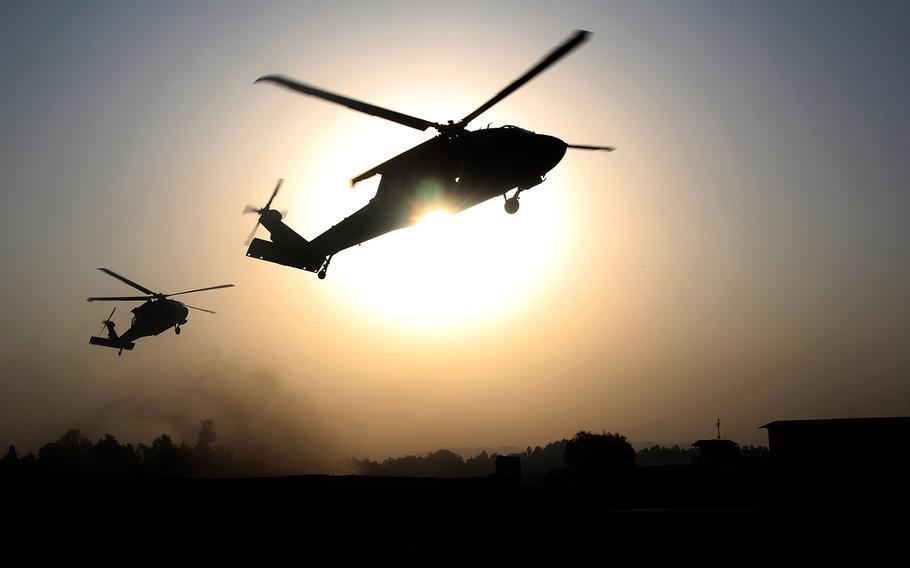 UH-60 Black Hawk helicopters from 101st Combat Aviation Brigade, 101st Airborne Division, hover over a Jalalabad Airfield landing zone in eastern Afghanistan, Sept. 16, 2015.