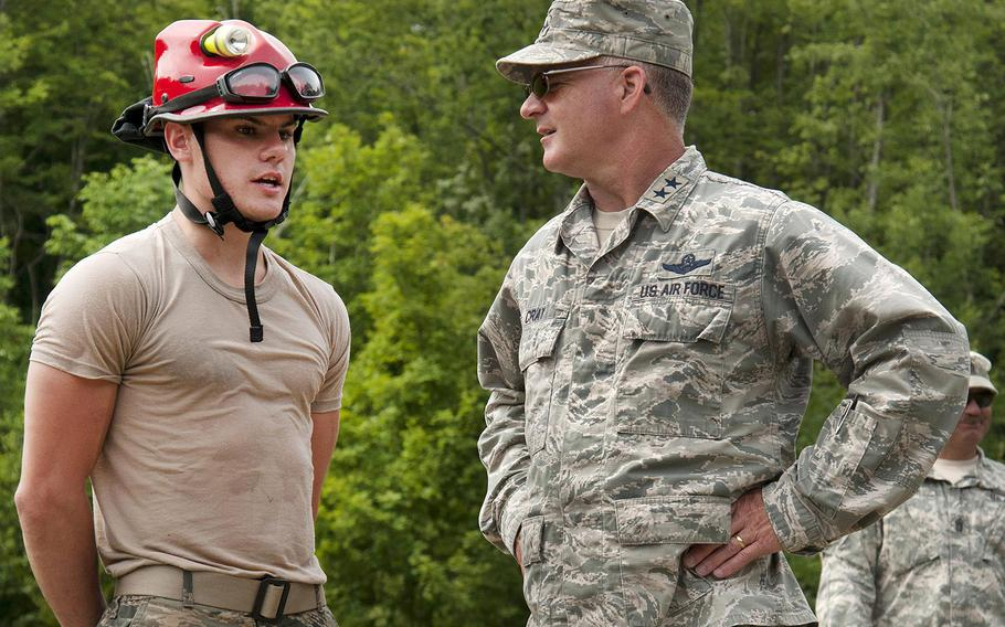 Air Force Airman 1st Class Reneau Bouchard, left, speaks with Air Force Maj. Gen. Steven Cray, adjutant general of the Vermont National Guard, about his role during Vigilant Guard 2016 at Camp Ethan Allen Training Site in Jericho, Vt., July 31, 2016.