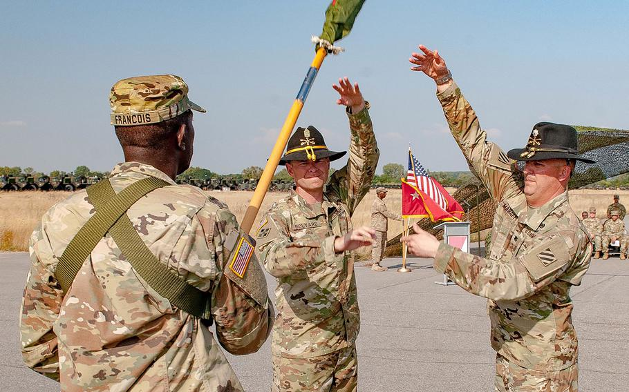 U.S. Army Lt. Col. Christopher S. Mahaffey, commander, and Command Sgt. Maj. Tim Bolyard (center), senior enlisted advisor, of 5th Squadron, 7th Cavalry Regiment, 3rd Infantry Division, stationed at Fort Stewart, Ga., finish casing their squadron colors Sep. 9, 2016, at Coleman Barracks in Mannheim, Germany.