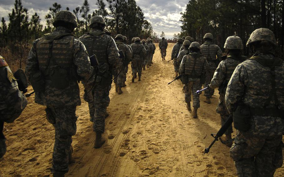 Army recruits practice patrol tactics while marching during U.S. Army basic training at Fort Jackson, S.C., Dec. 6, 2006.