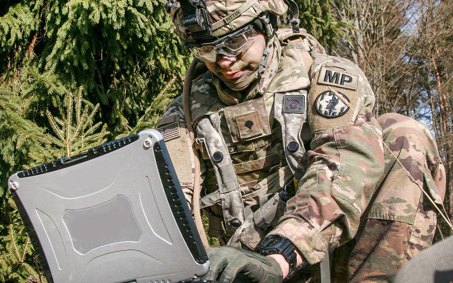 The Army Futures Command is developing wearable authentication tokens that will enable soldiers to prove their identity when operating systems, devices and applications on the Army tactical network. Here, Spc. William Ritter sets up software during Allied Spirit VIII at Hohenfels, Germany, Jan. 26, 2018.