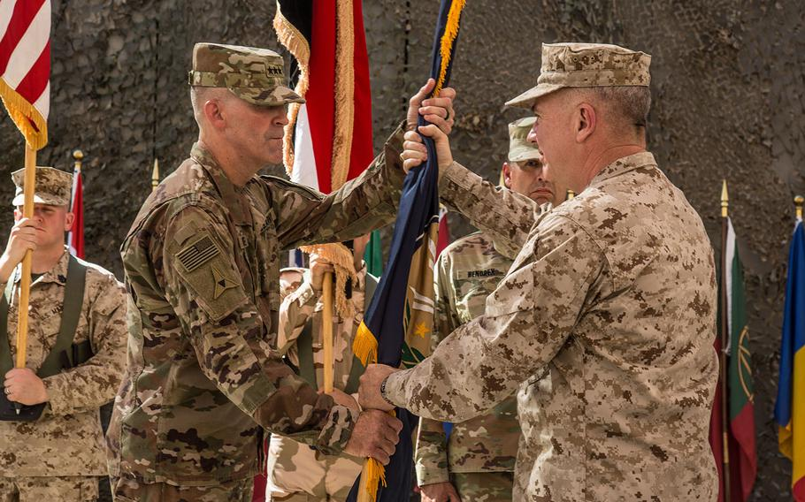 U.S Marine Corps Gen. Kenneth McKenzie, right, transfers authority of the Combined Joint Task Force- Operation Inherent Resolve to U.S. Army Lt. Gen. Robert White, leader of III Armored Corps, at the CJTF-OIR transfer-of-authority ceremony in Baghdad on Saturday, Sept. 14, 2019. The U.S. Army's XVIII Airborne Corps, deployed from Fort Bragg, N.C. to areas in Southwest Asia, transferred its command authority to the III Armored Corps, deployed from Fort Hood, Texas.